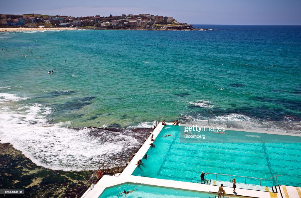 People swim in the pool of the Bondi Icebergs Swimming Club at Bondi Beach in Sydney, Australia, on Monday, Jan. 7, 2013. The Bureau of Statistics is scheduled to release retail sales data on Jan. 9. Photographer: Ian Waldie/Bloomberg via Getty Images