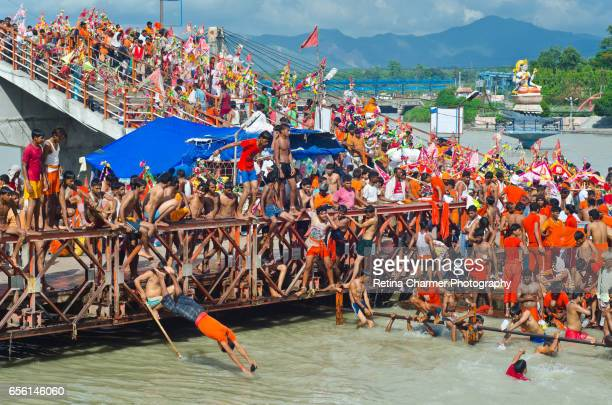 People Swimmig In Ganges Along WIth The Statue of Goddess Ganga in the background, Ganges River, Haridwar, Uttarakhand, India