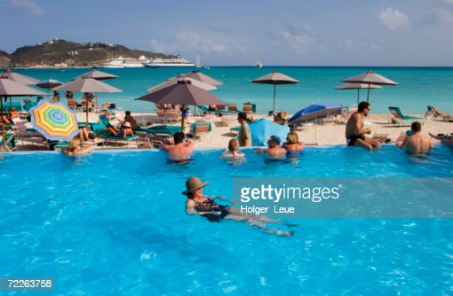 Hotel pool with people  People Swimming And Sunbathing At Great Bay Beach Hotel Pool ...