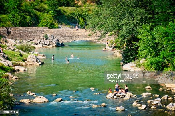 People swimming in a river near Kutaisi, Georgia - June 27, 2017