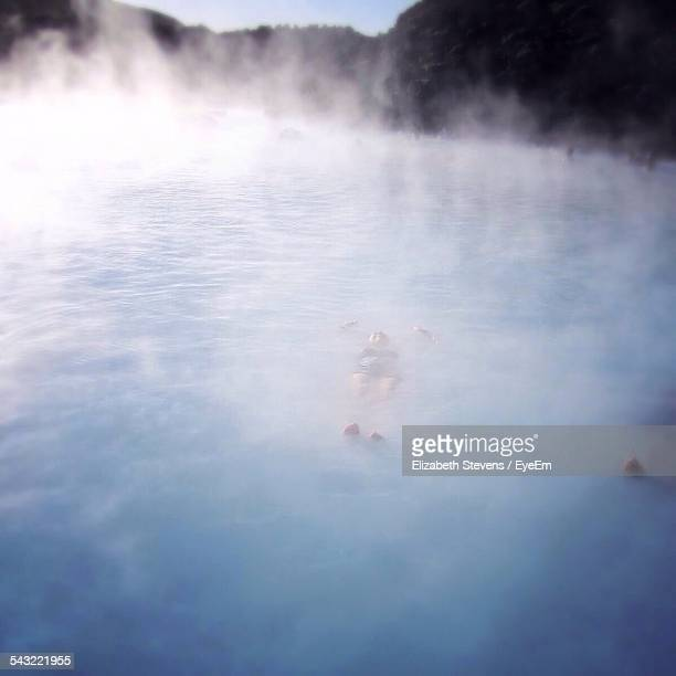 People Swimming In Blue Lagoon