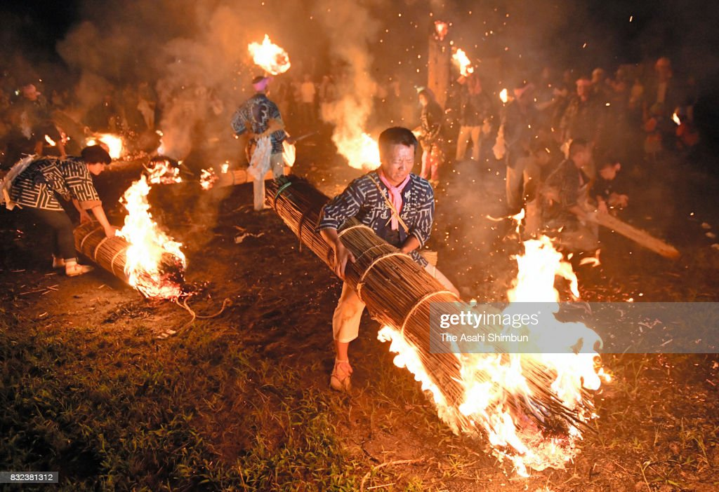 People swing flame torches during the 'Hiondori' ritual at the former battlefield of the Battle of Nagashino on August 15, 2017 in Shinshiro, Aichi, Japan. The ritual is to commemorate souls of samurai warriors died in the Battle of Nagashino in 1575, which the force of feudal warlord Oda Nobunaga won and pushed himself forward to the ruler of Japan.