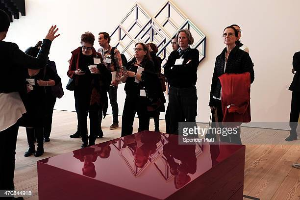 People take a gallery tour at the relocated Whitney Museum of American Art in Manhattan's meatpacking district on April 23 2015 in New York City The...
