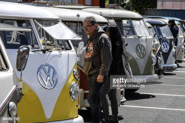 People take a look at Volkswagen vans on display in Le Versoud near Grenoble eastern France on May 20 2017 The lovers of the Volkswagen Kombi...