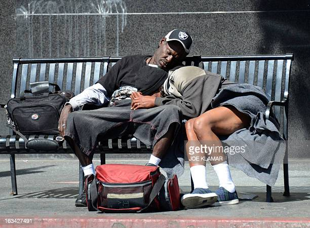 People take a nap at a bench in Hollywood California on March 9 2013 The Labor Department reported yesterday that 236000 jobs were added in February...