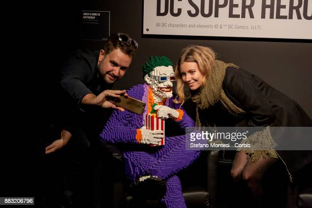 People take a selfie as they visit the 'The Art of the Brick DC Super Heroes' Exhibition at the Palace of Exams on November 30 2017 in Rome Italy The...