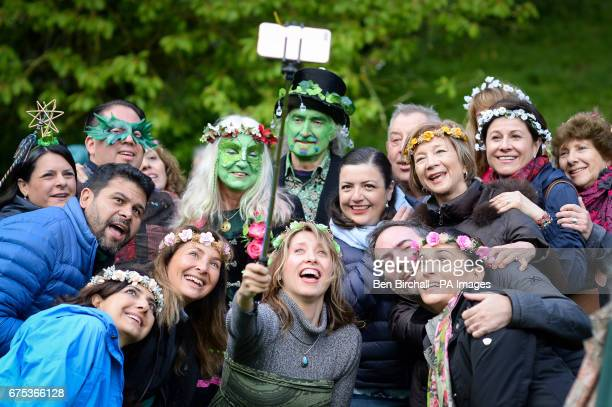 People take a selfie at Chalice Well Glastonbury where Beltane festivities are taking place on May Day
