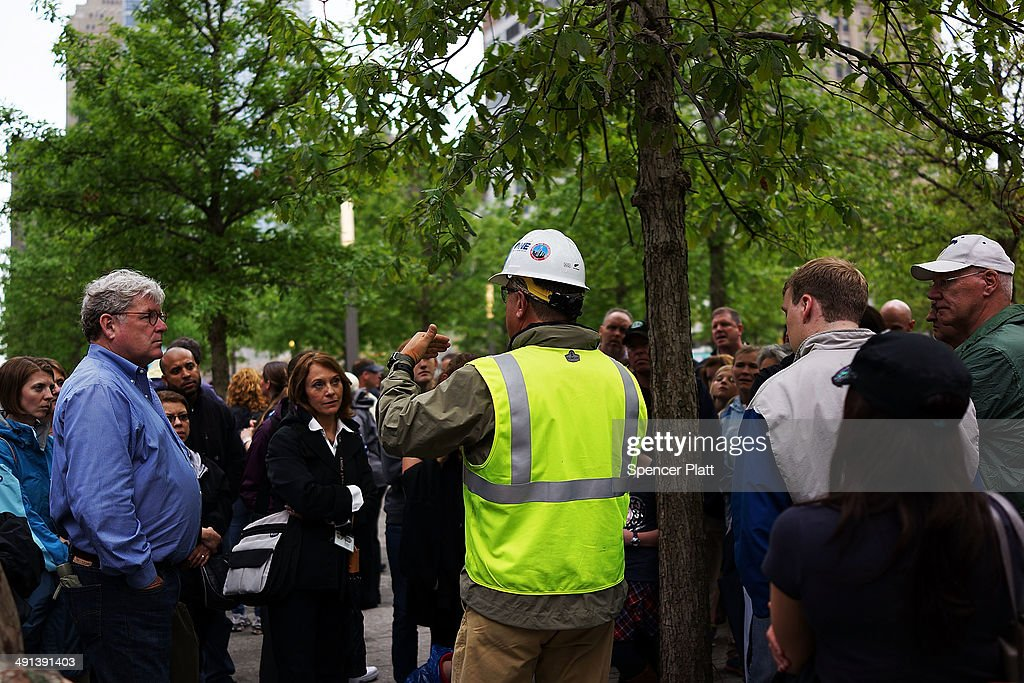 People take a tour of the Ground Zero memorial site after authorities opened the plaza to the public free of charge on May 16, 2014 in New York City. Prior to today, visitors had to wait in line to enter a barricaded area which includes the newly dedicated National September 11 Memorial Museum. Together with the museum, Ground Zero has become one of the top tourist attractions in the nation with tens of thousands of visitors expected yearly.