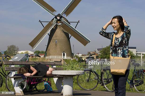 People take advantage of a sunny day on May 10 2008 at Kinderdijk during National Windmill day in The Netherlands AFP PHOTO ED OUDENAARDEN...