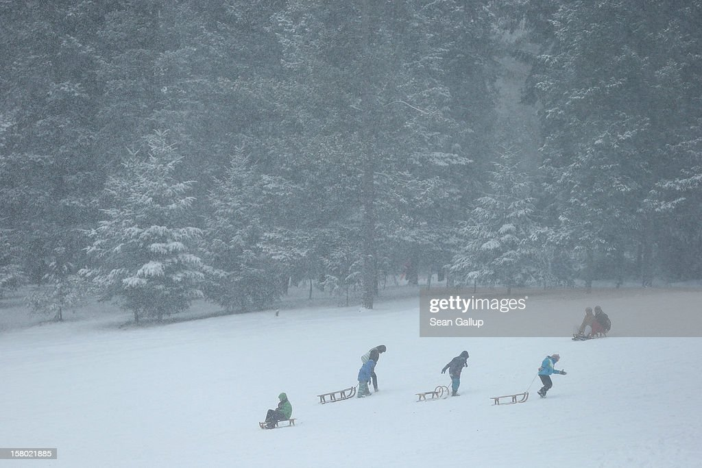 People take advantage of fresh snow to go sledding at a snow-covered park in Zehlendorf district on December 9, 2012 in Berlin, Germany. Northeastern Germany was inundated with a heavy snowfall that covered highways and blanketed the region with heavy snow.