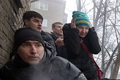 People take cover during a shelling in a residential area in Donetsk's Kyibishevsky district on January 30 2015 Twentyfour people including 19...