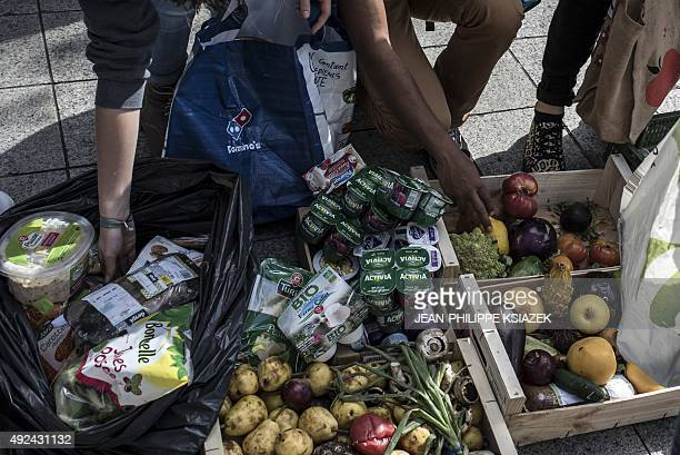 People take food that has been collected the night before from waste containers of a supermarket by members of the movement 'Les Gars'Pilleurs' in...