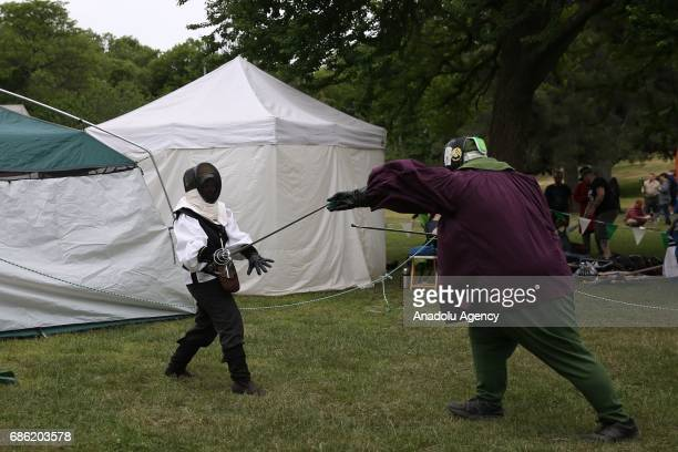 People take part as raiders from the 11th Century sail into Owls Head Park in Bay Ridge for the 17th Annual Viking Fest on May 20 when three...