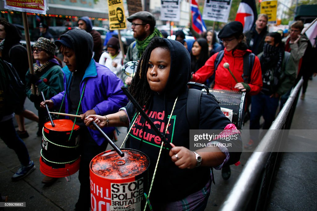 People take part during the May Day demonstration in Washington Square Park on May 1, 2016 in New York. Thousands are expected to take part in May Day rallies across the country to supprot workers rights. / AFP / KENA