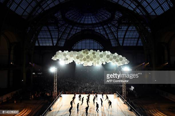 TOPSHOT People take part in a ball under the nave of the Grand Palais in Paris on July 13 2017 Seven choreographers will reinterpret in their own way...