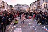 People take part in a candle light vigil for the victims of the Paris attacks in the Molenbeek district of Brussels Belgium on November 18 2015