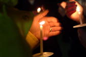 People take part in a candlelight vigil commerating the 90th anniversary of the Armenian Genocide outside the Century for the Performing Arts at the...