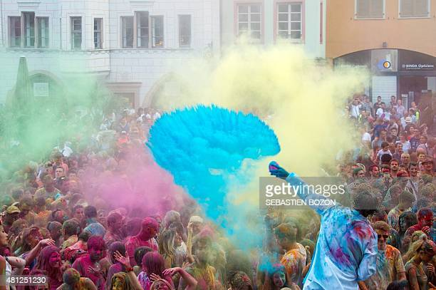 People take part in a colour battle organised by the Artonik company during a street theater festival in Mulhouse on July 18 2015 AFP PHOTO /...
