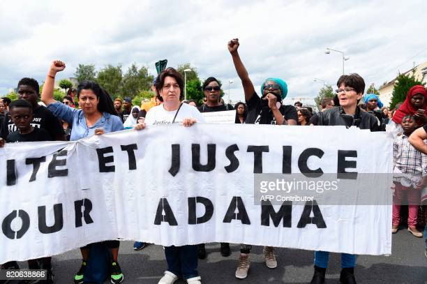 People take part in a commemorative march on July 22 2017 in BeaumontsurOise northeast of Paris in memory of Adama Traore who died during his arrest...
