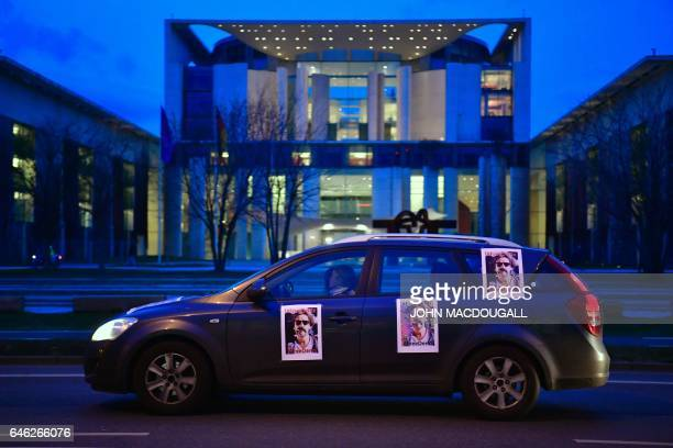 People take part in a convoy protest for the release of journalist for the German Die Welt newspaper Deniz Yucel detained in Turkey in front of the...