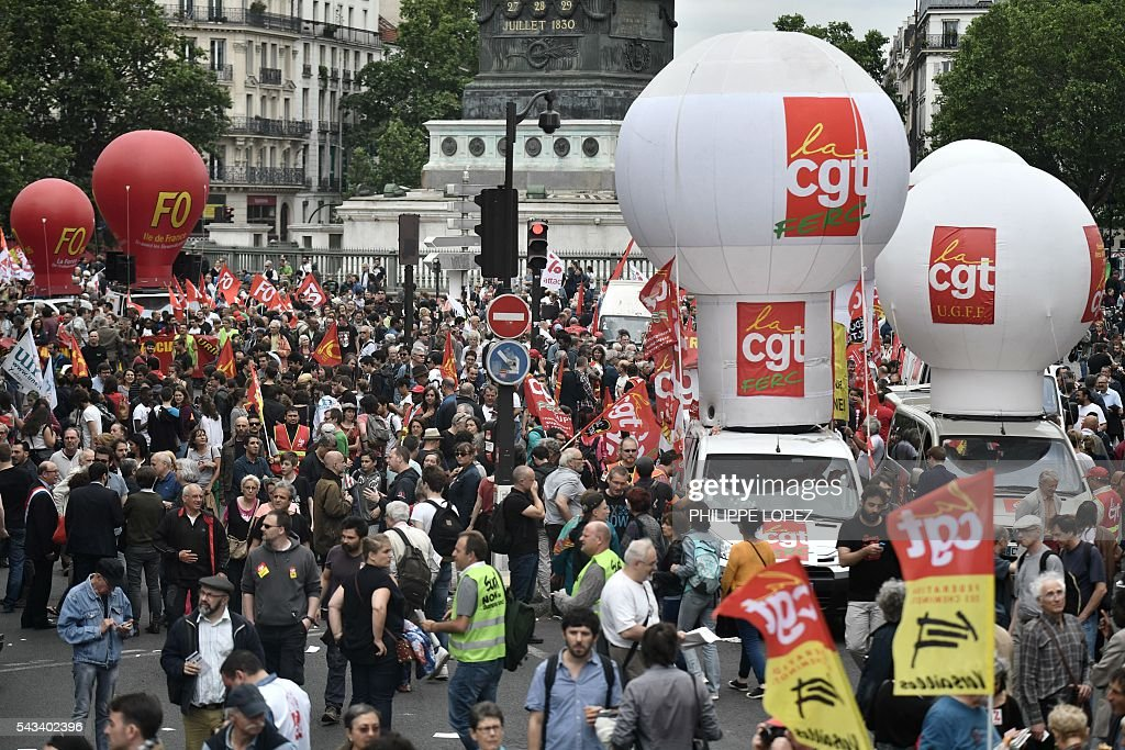 People take part in a demonstration against controversial labour reforms, on June 28, 2016 on Bastille Square in Paris. Unions have called repeated strikes and marches in opposition to the law, which seeks to bring down France's intractable 10-percent unemployment rate by making it easier to hire and fire workers. / AFP / PHILIPPE