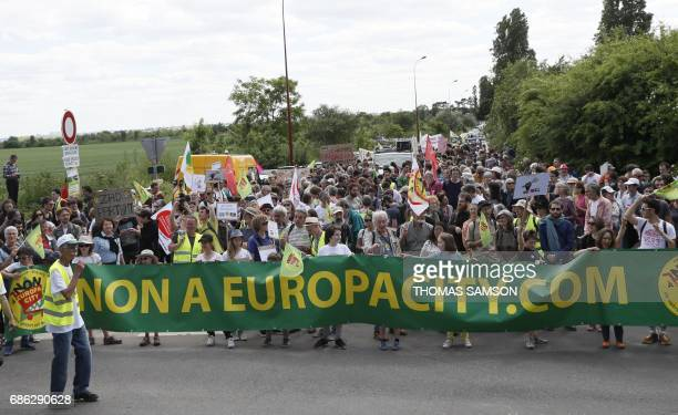 People take part in a demonstration against 'EuropaCity' a project of a giant commercial and leisure complex developed by Auchan retail French group...