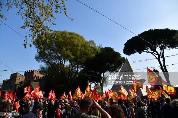 People take part in a demonstration against Europe near the Pyramid of Cestius on March 25 2017 in Rome Italian capital hosts a special summit of...