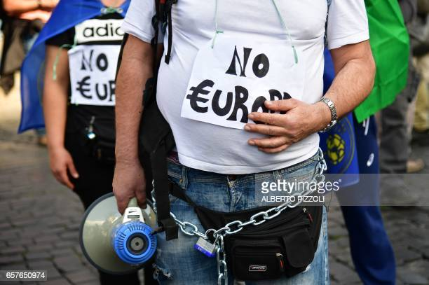 People take part in a demonstration against the European Union on March 25 2017 in Rome Italian capital hosts a special summit of European leaders...