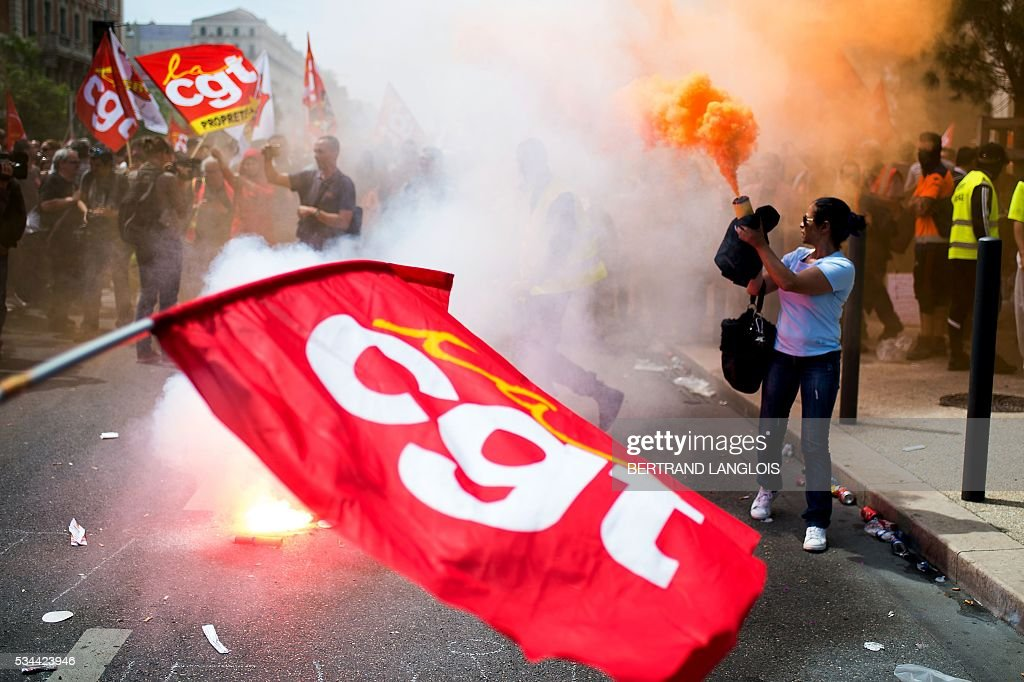 TOPSHOT People take part in a demonstration against the French government's planned labour law reforms in front of Les Terrasses du Port commercial...