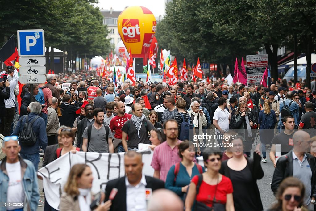 People take part in a demonstration against the series of controversial labour reforms on June 28, 2016 in Paris. / AFP / Thomas SAMSON
