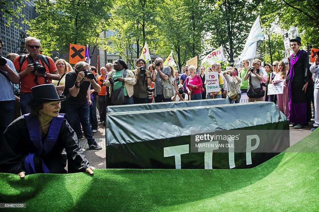 People take part in a demonstration against the Transatlantic Trade and Investment Partnership (TTIP), in Amsterdam, on May 28, 2016. Washington and Brussels want the Transatlantic Trade and Investment Partnership (TTIP) completed this year before US President leaves office, but it has faced mounting opposition especially in France and Germany. / AFP / ANP / Marten van Dijl / Netherlands OUT
