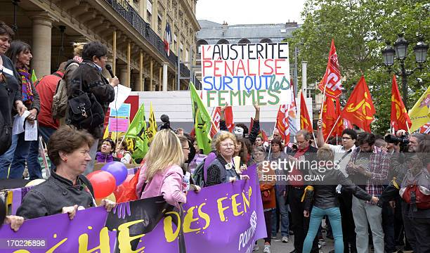 People take part in a demonstration called by feminist organizations to denounce the government's economic austerity measures which they say 'women...
