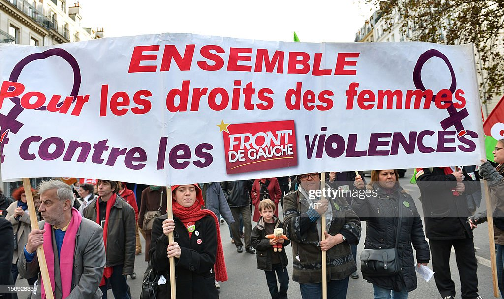 people take part in a demonstration called by the Women rights national collective, on November 25, 2012 in Paris, as part of the International Day for the Elimination of Violence Against Women. Since 1999, the United Nations each year invites governments, international organizations and NGOs to organize activities designed to encourage the public to fight such violence. Banner reads: 'Together for women rights , against violences.'.