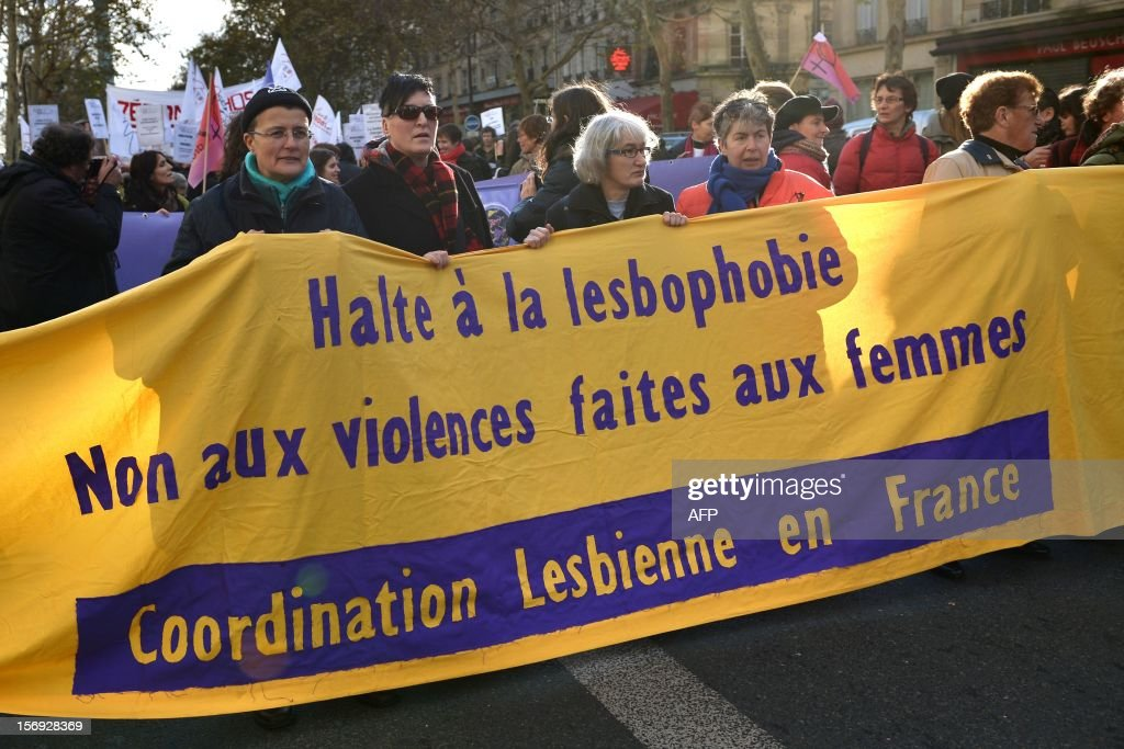 people take part in a demonstration called by the Women rights national collective, on November 25, 2012 in Paris, as part of the International Day for the Elimination of Violence Against Women. Since 1999, the United Nations each year invites governments, international organizations and NGOs to organize activities designed to encourage the public to fight such violence. AFP PHOTO BERTRAND LANGLOIS