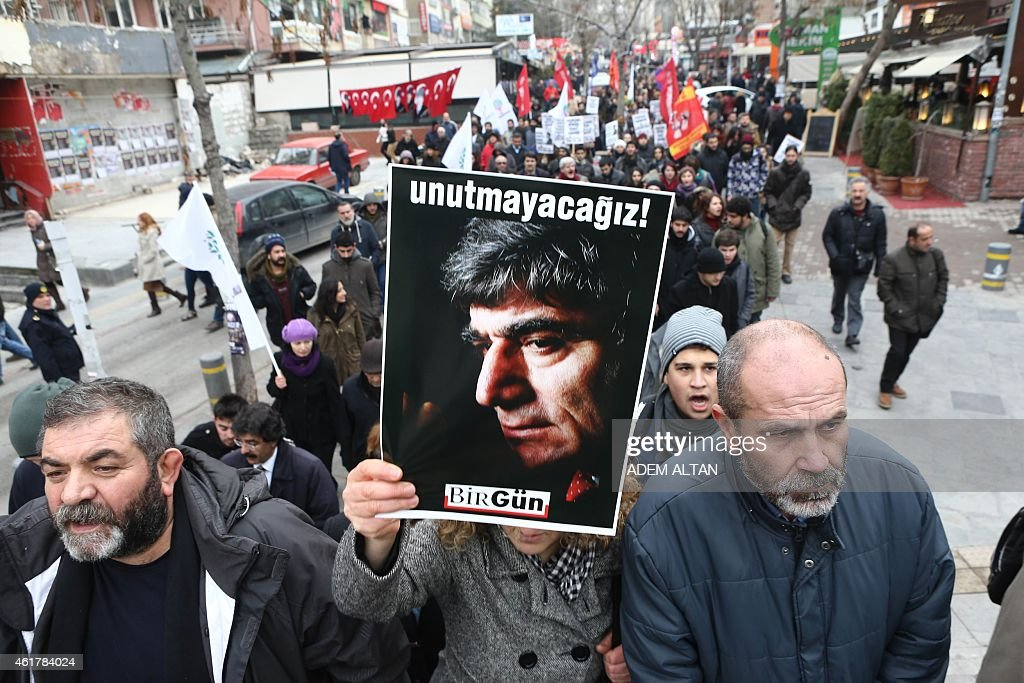 People take part in a demonstration calling for justice over the murder of Turkish-Armenian journalist <a gi-track='captionPersonalityLinkClicked' href=/galleries/search?phrase=Hrant+Dink&family=editorial&specificpeople=741548 ng-click='$event.stopPropagation()'>Hrant Dink</a> on January 19, 2015 in Ankara. Dink, 52, was shot dead with two bullets to the head in broad daylight outside the offices of Agos on January 19, 2007. AFP PHOTO / ADEM ALTAN