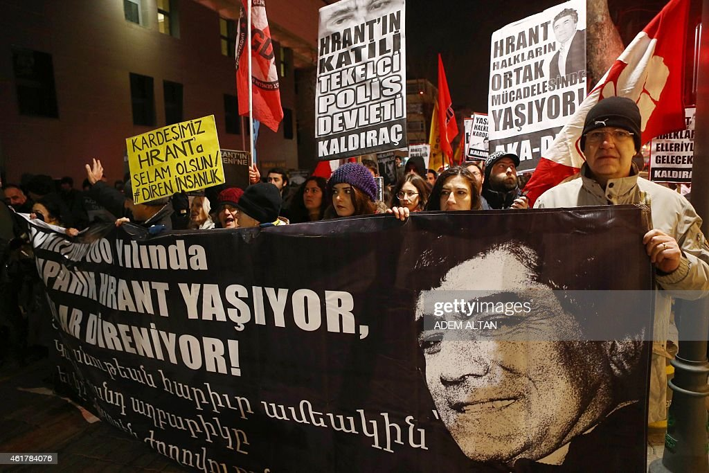 People take part in a demonstration calling for justice over the murder of Turkish-Armenian journalist <a gi-track='captionPersonalityLinkClicked' href=/galleries/search?phrase=Hrant+Dink&family=editorial&specificpeople=741548 ng-click='$event.stopPropagation()'>Hrant Dink</a> on January 19, 2015 in Ankara. Dink, 52, was shot dead with two bullets to the head in broad daylight outside the offices of Agos on January 19, 2007.