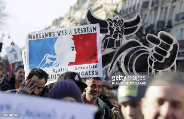 People take part in a demonstration for the legalisation of gay marriage and LGBT parenting in Paris on January 27 two days before a parliamentary...