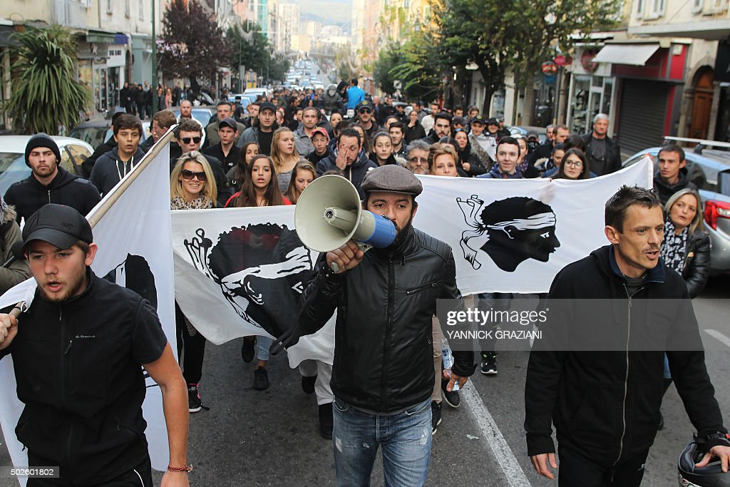 People take part in a demonstration in Ajaccio on December 27 after France banned demonstrations in part of the Corsican capital Ajaccio following...