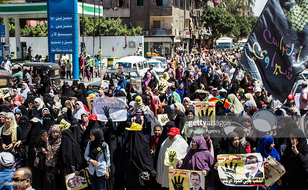People take part in a demonstration in return to protest call of Egyptian National Alliance for anti-coup and support to legality in Cairo, Egypt on 9 May, 2014.