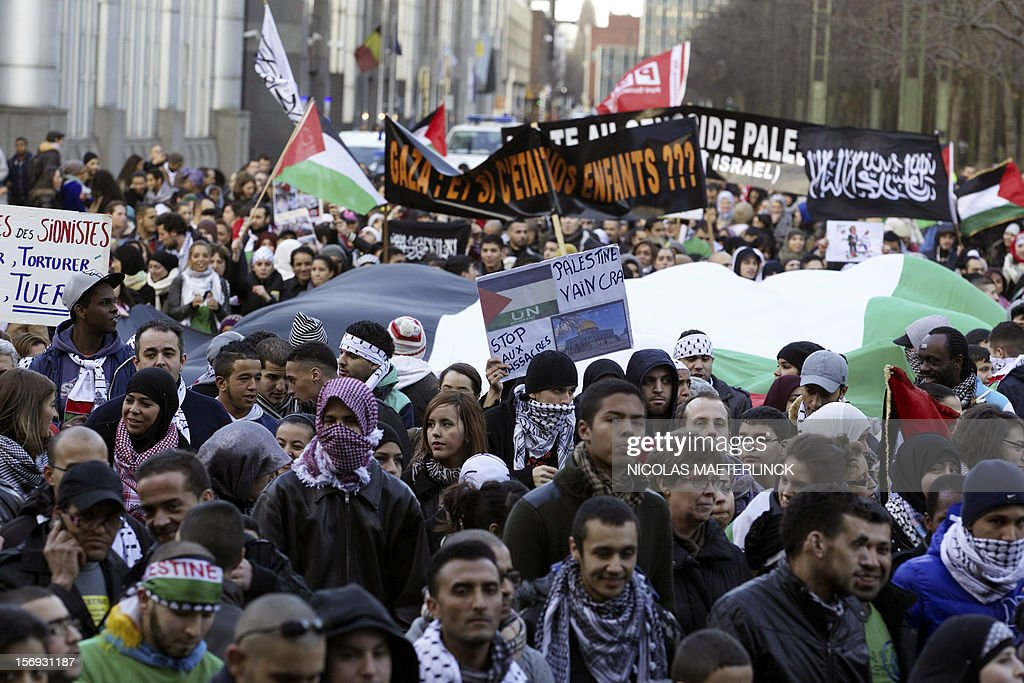 People take part in a demonstration in solidarity with Palestinians and denouncing recent Israeli bombardments on Gaza, on November 25, 2012, in Brussels. AFP PHOTO / BELGA / NICOLAS MAETERLINCK