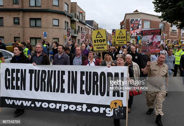 People take part in a demonstration of farright organisation Voorpost protesting against EU membership for Turkey on September 17 2016 in Gent / AFP...
