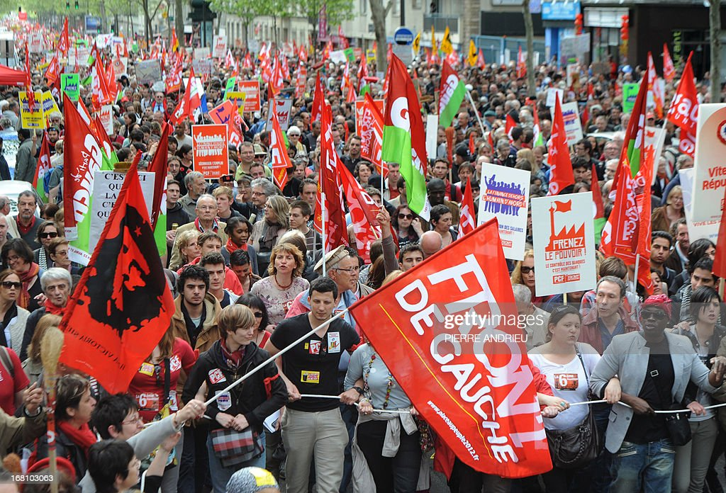 People take part in a demonstration on May 5, 2013 in Paris, called by Jean-Luc Melenchon, leader of Front de Gauche (Left Front) left wing party, to protest 'against the austerity, against the finance and to ask for a Sixth Republic'. When France's president Francois Hollande swept to power on May 2012 on a wave of discontent, he could hardly have imagined that a year later he would be the most unpopular president in modern French history.
