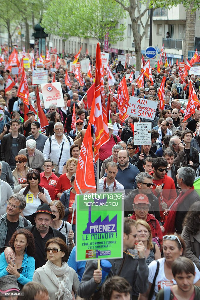 People take part in a demonstration on May 5, 2013 in Paris, called by Jean-Luc Melenchon, leader of Front de Gauche (Left Front) left wing party, to protest 'against the austerity, against the finance and to ask for a Sixth Republic'. When France's president Francois Hollande swept to power on May 2012 on a wave of discontent, he could hardly have imagined that a year later he would be the most unpopular president in modern French history. AFP PHOTO / PIERRE ANDRIEU
