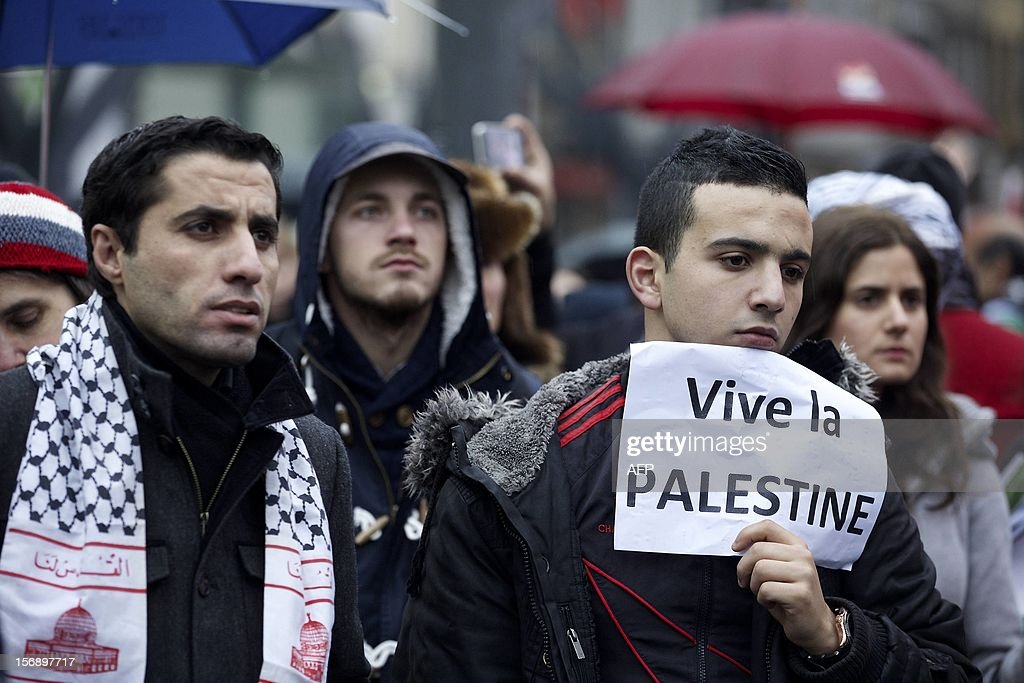 People take part in a demonstration organized by the Belgo-Palestinian association in solidarity with the Palestinians and over Israel's air campaign on Gaza on, November 24, 2012 in Brussels.