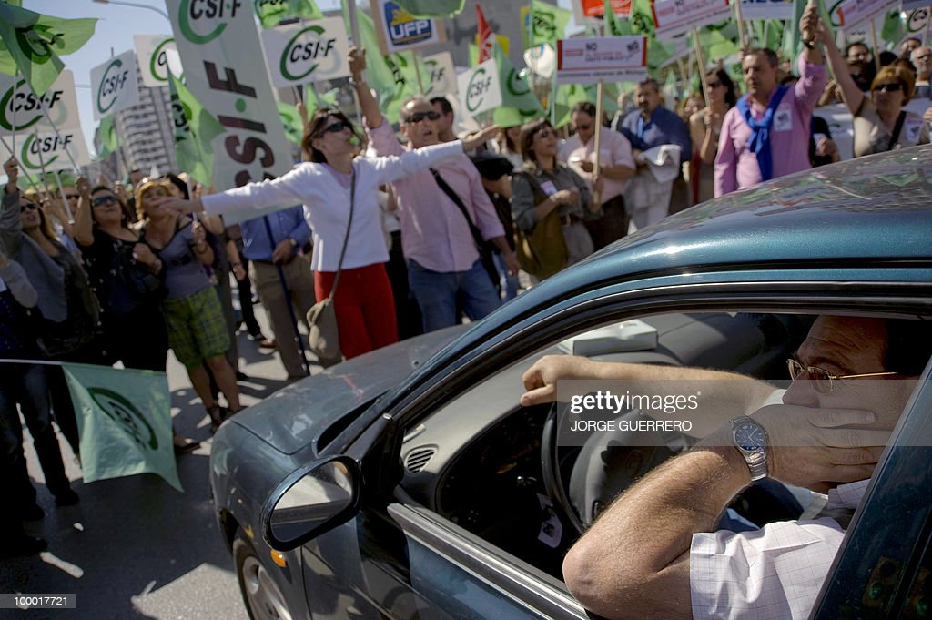 People take part in a demonstration to protest about cuts announced by the Government, in Malaga on May 20, 2010.