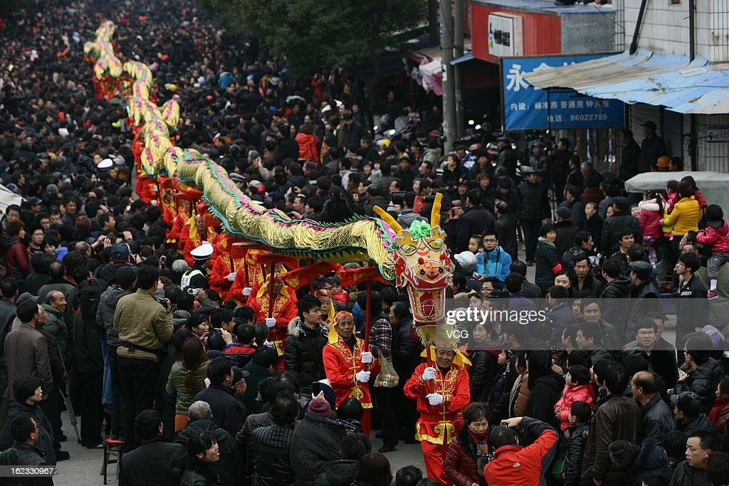 People take part in a dragon dance to celebrate the Spring Festival on February 21, 2013 in Ningbo, China. The Chinese Lunar New Year of Snake also known as the Spring Festival, which is based on the Lunisolar Chinese calendar, is celebrated from the first day of the first month of the lunar year and ends with Lantern Festival on the Fifteenth day.