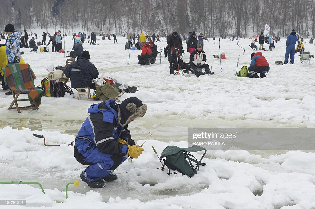 STORY - People take part in a fishing event on the frozen lake Viljandi, in Viljandi, Estonia on February 16, 2013. More than 8,000 participants from different countries arrived for the fishing event.