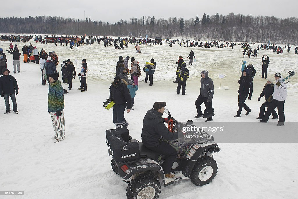 STORY - People take part in a fishing event on the frozen lake Viljandi in Viljandi, Estonia on February 16, 2013. More than 8,000 participants from different countries arrived for the fishing event.