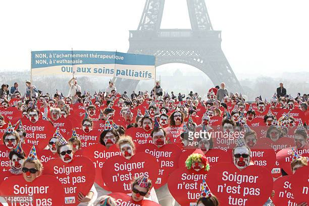 People take part in a flash mob event organized by the 'Alliance VITA' association as part of their tour of France in solidarity with elderly people...