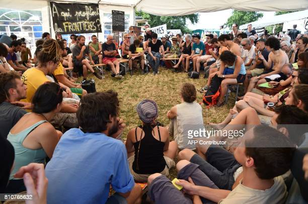 People take part in a forum during a twoday meeting organised by opponents to a controversial international airport project in the area on July 8 in...
